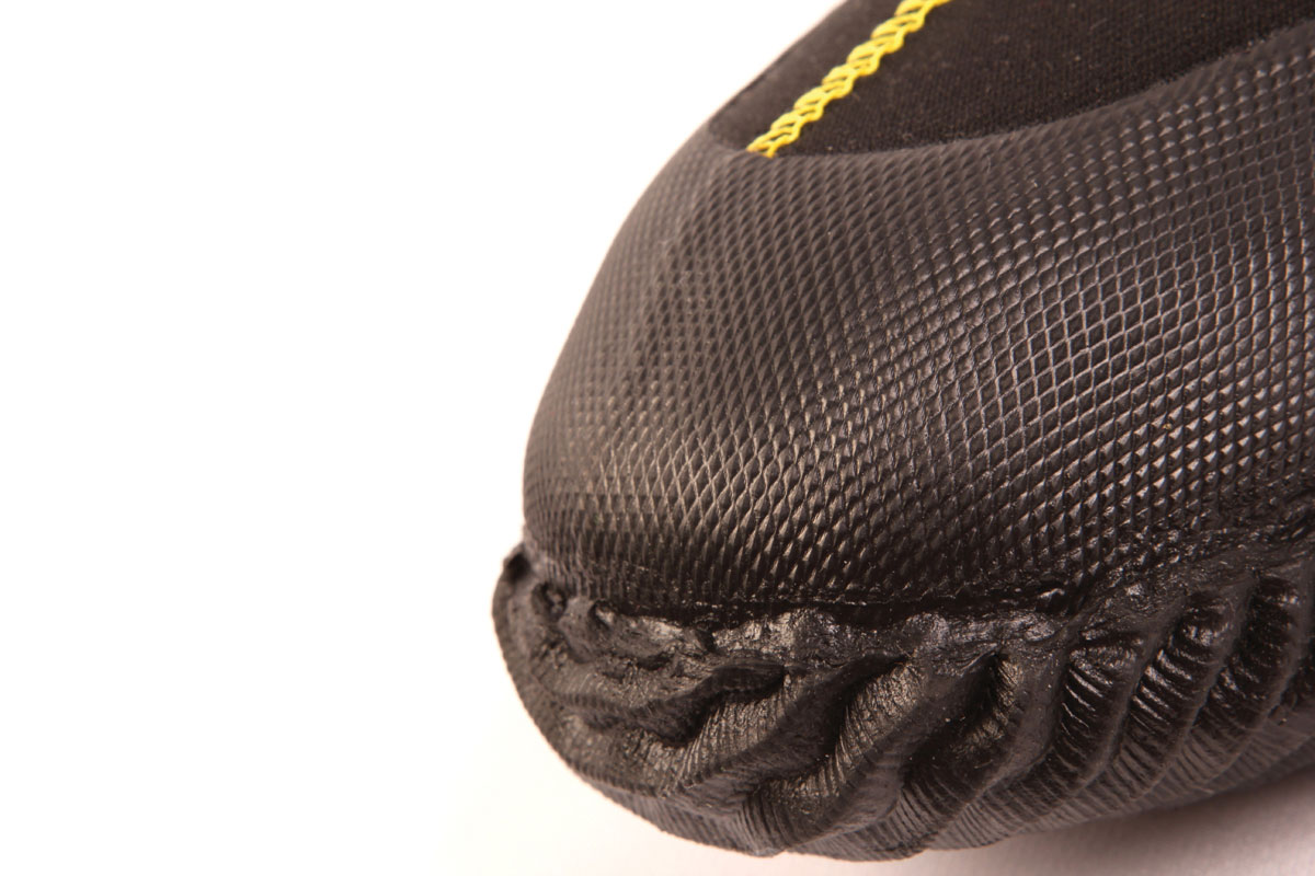 Moulded rubber toe cap with ridged underside to help when climbing steep and/or muddy slopes