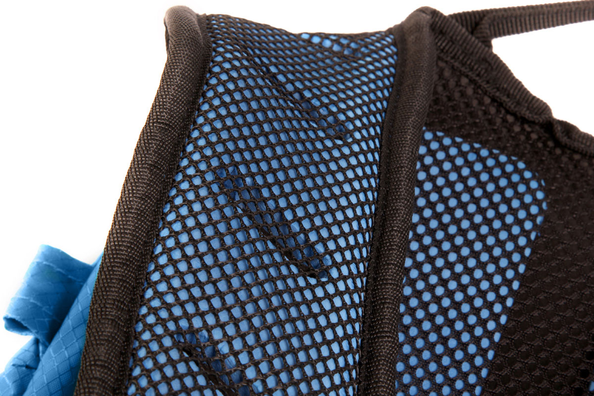 Pre-shaped, lightweight perforated foam shoulder strap construction provides comfort and ventilation