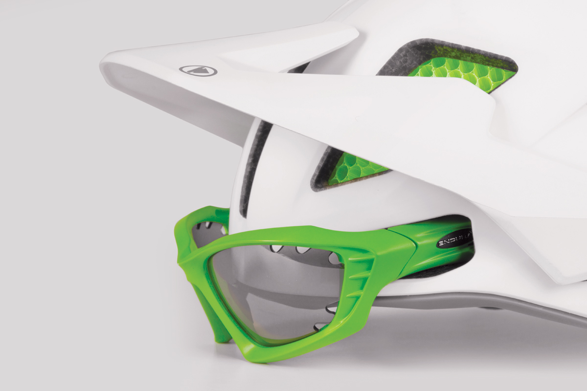 Front eyewear dock and goggle compatibile including rear strap clip