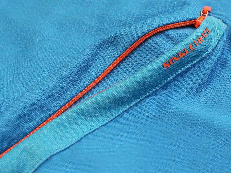 Discreet rear zipped media pocket