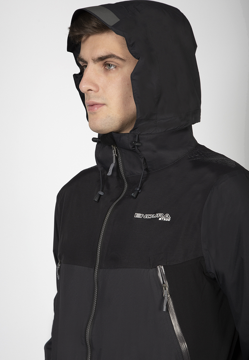 3D adjustable hood with collar retention system